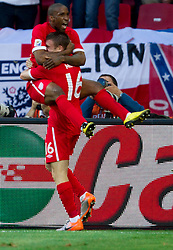 Jermain Defoe of England and James Milner of England celebrate during the 2010 FIFA World Cup South Africa Group C Third Round match between Slovenia and England on June 23, 2010 at Nelson Mandela Bay Stadium, Port Elizabeth, South Africa.  (Photo by Vid Ponikvar / Sportida)