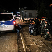KASTANIES, GREECE - FEBRUARY 28: Frontex border guards detain migrants from Afghanistan and Eritrea who crossed into the country from the Turkish border on Friday, February 28, 2020. Turkey said it would no longer stop refugees from reaching Europe a day after the country suffered heavy losses during an attack in Syria. (Photo by Byron Smith/Getty Images)