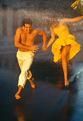 couple running through water on a New York City street