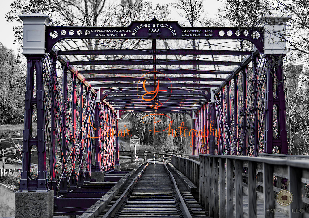 The Bollman Truss Railroad Bridge at Savage, Maryland is the sole surviving example of a revolutionary design in the history of American bridge engineering. The 160-foot (48.8 m) double-span truss bridge is one of the oldest standing iron railroad bridges in the United States. Please select Shopping Cart Below to Purchase prints and gallery-wrapped canvases, magnets, t-shirts and other accessories