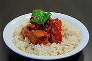Goulash on rice garnished with parsley