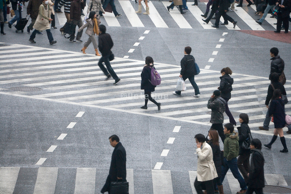 starting to cross at the Hachiko pedestrian crossing in Shibuya Tokyo