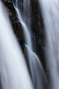 A small waterfall develops between the two main streams of Snoqualmie Falls in Snoqualmie, Washington.