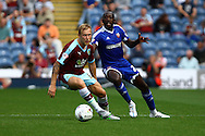 Scott Arfield of Burnley gets in front of Toumani Diagouraga of Brentford. Skybet football league championship match, Burnley  v Brentford at Turf Moor in Burnley, Lancs on Saturday 22nd August 2015.<br /> pic by Chris Stading, Andrew Orchard sports photography.
