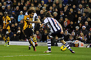 Hull city's Tom Huddlestone (8) shoots at goal but his shot is saved by West Brom keeper Ben Foster (not in pic).   Barclays Premier league, West Bromwich Albion v Hull city at the Hawthorns in West Bromwich, England on Saturday 21st Dec 2013. pic by Andrew Orchard, Andrew Orchard sports photography.