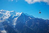 La Flégère Gondola passing Mont Blanc and the snowy French Alps - Chamonix, France.