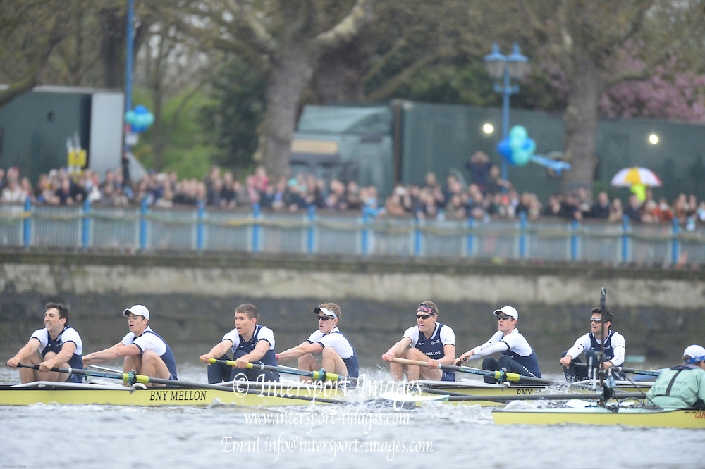 London, United Kingdom.  2014 Varsity Boat Race between Oxford University and Cambridge University Boat Clubs over the  Putney to Mortlake  Championship Course,  River Thames;   17:59:16 - Sunday  - 06/04/2014  [Mandatory Credit; Peter SPURRIER/Intersport Images].