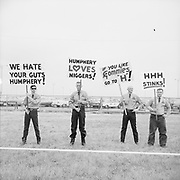 ackroyd-P095-02. (White supremacists picket the arrival of Vice-President Hubert Humphrey at Portland Airport, June 11, 1965. The Voting Rights Act of 1965, prohibiting racial discrimination in voting, was before Congress at this time.)