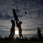 """Pupils practice rugby on the playing fields of Rugby School in central England, January 20, 2015.  The public school, founded in 1567 was amongst the first """"Public"""" schools in England. The school is known as the home of rugby. Local legend  states that in 1823 pupil William Webb Ellis first ran with the ball inventing the game of rugby football which took its name from the school. In 2015 20 countries will compete in the Rugby World Cup which is hosted by England REUTERS/Neil Hall"""