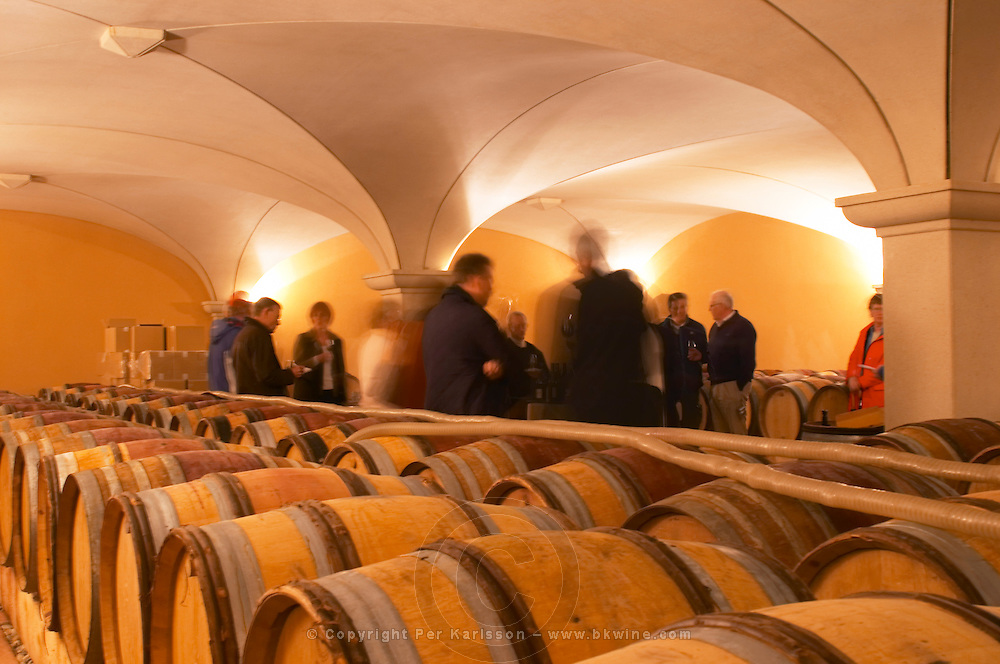 Visitors blurred in the barrel aging cellars with vaulted ceiling. Domaine Gilles Robin, Les Chassis, Mercurol, Drome, Drôme, France, Europe