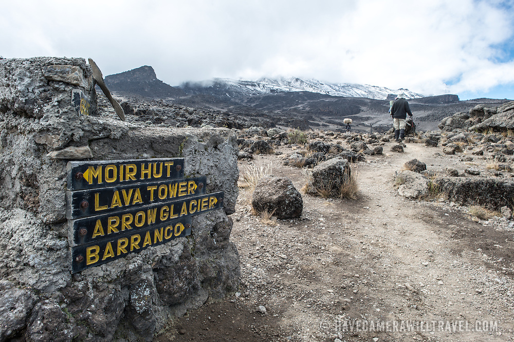 A rare directions sign amidst the rocky, rugged apline desert on Mt Kilimanjaro Lemosho Route. These shots were taken on the trail between Moir Hut Camp and Lava Tower at approximately 14,500 feet.