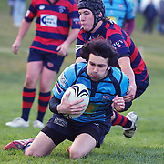 Richard Sim evades the tackle of Blake Lindsey to score a try for Wakatipu during the Wakatipu V Arrowtown Rugby Match at Queenstown Recreation Ground,  Queenstown, South Island, New Zealand, 11th June 2011