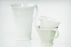 Close-up of white cups and pitcher, Bavaria, Germany