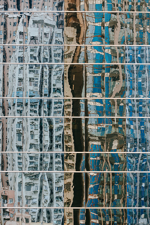 Reflections of buildings on the windows of adjacent skyscrapes in Central, Hong Kong Island, on October 14, 2019.