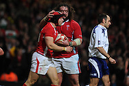 Leigh Halpenny of Wales celebrates his 1st try with Adam Jones. RBS Six nations championship 2012, Wales v Scotland at the Millennium Stadium in Cardiff on Sunday 12th Feb 2012.  pic by Andrew Orchard, Andrew Orchard sports photography,