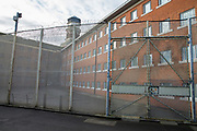 The fenced off exercise yard outside the newly refurbished cell windows of C wing. HMP YOI Winchester was built in 1846 and is typical of the Victorian prison, radial design. It is currently a Category B Local prison that serves the local courts, has an operational capacity of 690 and is able to take men from the age of 18 upwards.  HMP Winchester, Hampshire, United Kingdom. (All image use MUST be credited © prisonimage.org)