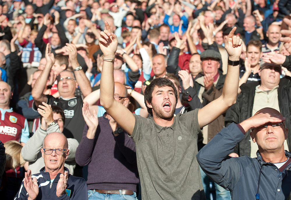 Burnley fans cheer after their team earn a point with a goal in the sixth minute of added time<br /> <br /> Photographer Stephen White/CameraSport<br /> <br /> Football - Barclays Premiership - Leicester City v Burnley - Saturday 04th October 2014 - King Power Stadium - Leicester<br /> <br /> © CameraSport - 43 Linden Ave. Countesthorpe. Leicester. England. LE8 5PG - Tel: +44 (0) 116 277 4147 - admin@camerasport.com - www.camerasport.com