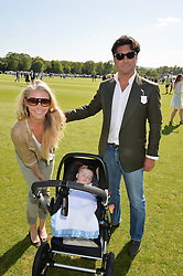 TAMARA BECKWITH and GIORGIO VERONI and their son at the St.Regis International Polo Cup at Cowdray Park, Midhurst, West Sussex on 16th May 2015.