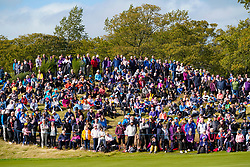 Auchterarder, Scotland, UK. 15 September 2019. Sunday Singles matches on final day  at 2019 Solheim Cup on Centenary Course at Gleneagles. Pictured; Large crowd of spectators on hill beside the 10th green.  Iain Masterton/Alamy Live News