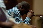 A man prays during a memorial service for Ebola patient Thomas Eric Duncan at Wilshire Baptist Church on October 8, 2014, in Dallas. (Cooper Neill for The New York Times)
