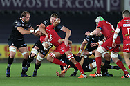 Aaron Shingler of the Scarlets © is brought to a halt by Alun Wyn Jones (l), Bradley Davies and James King of the Ospreys (on ground).  Guinness Pro14 rugby match, Ospreys v Scarlets at the Liberty Stadium in Swansea, South Wales on Saturday October 7th 2017. <br /> pic by Andrew Orchard, Andrew Orchard sports photography.