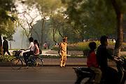 Hanoi, Vietnam police officer monitors morning traffic.