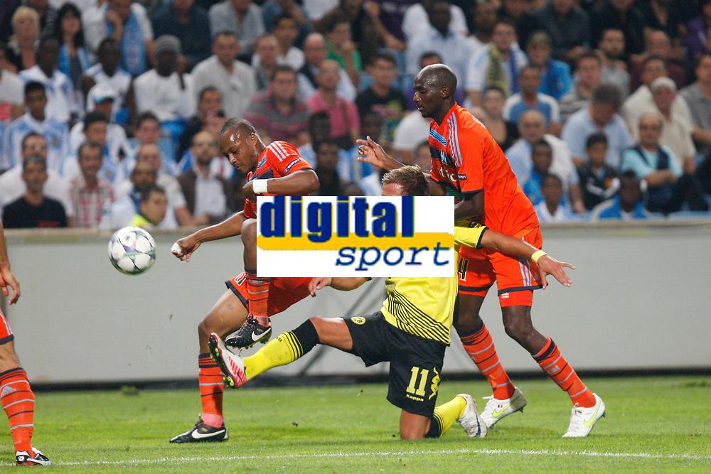 FOOTBALL - UEFA CHAMPIONS LEAGUE 2011/2012 - GROUP STAGE - GROUP F - OLYMPIQUE DE MARSEILLE v BORUSSIA DORTMUND - 28/09/2011 - PHOTO PHILIPPE LAURENSON / DPPI - MARIO GOTZE (DOR) / ANDRE AYEW / ALOU DIARRA (OM)