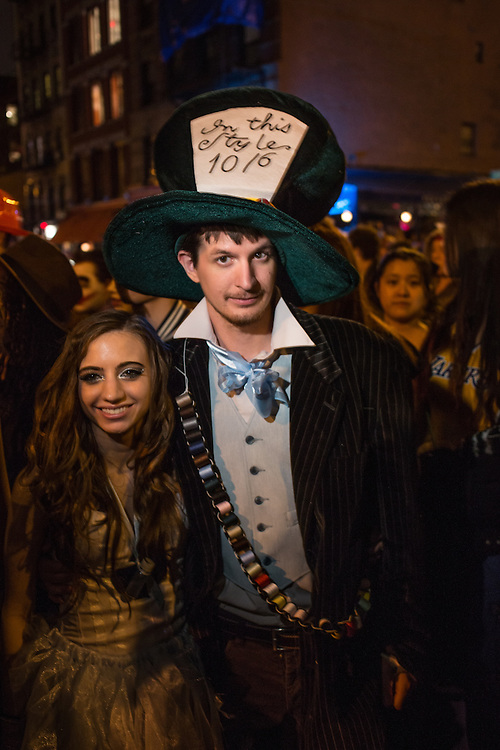 New York, NY, October 31, 2013. A couple dressed as the Mad Hatter and Alice from Lewis Carroll's Alice in Wonderland in New York's Greenwich Village Halloween Parade.