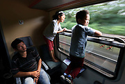 Young Afghan migrants are seen on a train travelling from Budapest to Gyor, Hungary, September 3 2015. An estimated 3,000 people were believed to be camped out at the station as authorities opened the doors to those without European visas or travel documents to board trains.