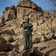 April 28, 2012 - Buram, Nuba Mountains, South Kordofan, Sudan: A SPLA-North fighter takes guard near some temporary houses in the caves outside Buram village in South Kordofan's Nuba Mountains...Since the 6th of June 2011, the Sudan's Army Forces (SAF) initiated, under direct orders from President Bashir, an attack campaign against civil areas throughout the South Kordofan's province. Hundreds have been killed and many more injured...Local residents, of Nuba origin, have since lived in fear and the majority moved from their homes to caves in the nearby mountains. Others chose to find refuge in South Sudan, driven by the lack of food cause by the agriculture production halt due to the constant bombardments of rural areas. (Paulo Nunes dos Santos/Polaris)