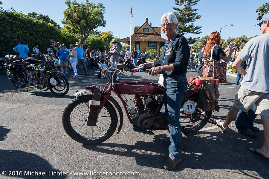 This is the end my friend, 3,400 miles from the Atlantic to the Pacific. The journey is over. Linda Monahan of California with her 1914 Indian class-3 bikez at the finish line of the Motorcycle Cannonball Race of the Century. Stage-15 ride from Palm Desert, CA to Carlsbad, CA. USA. Sunday September 25, 2016. Photography ©2016 Michael Lichter.