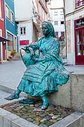 Statue of traditional Portuguese woman in the historical center near the Arco de Almedina. Coimbra, Portugal