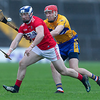 Cork's Stephen McDonald is pursued by Clare's Niall Deasy