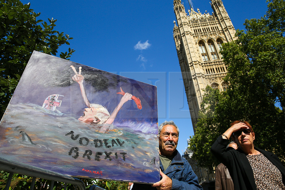 © Licensed to London News Pictures. 04/009/2019. London, UK. Artist KAYA MAR with his latest piece of satirical artwork showing the British Prime Minister Boris Johnson drowning in the sea outside Victoria Tower in Westminster. Photo credit: Dinendra Haria/LNP