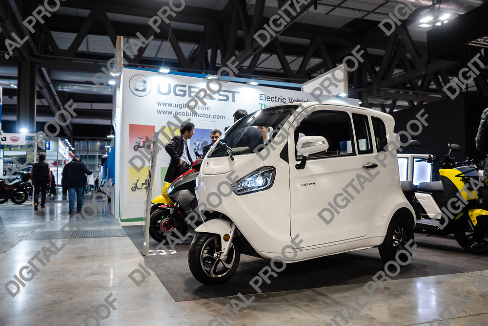 RHO Fieramilano, Milan Italy - November 07, 2019 EICMA Expo. Cab Easy Electric tricycle vehicle from UGBEST Chinese company in exhibition