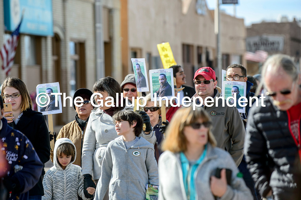 Marchers stride down Historic Highway 66 during the  Martin Luther King Jr. Day march in Gallup Monday.