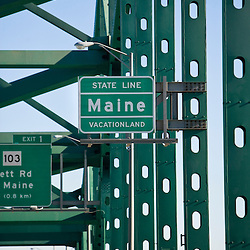 Maine state line sign on the Piscataqua River bridge.  I-95. Between Kittery, Maine and Portsmouth, new Hampshire.