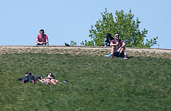 © Licensed to London News Pictures. 23/04/2020. London, UK. People relaxing in the sun on Primrose Hill, north London during a pandemic outbreak of the Coronavirus COVID-19 disease. The public have been told they can only leave their homes when absolutely essential, in an attempt to fight the spread of coronavirus COVID-19 disease. Photo credit: Ben Cawthra/LNP. Photo credit: Ben Cawthra/LNP