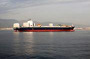 Container ship at moorings off Gibraltar, Port of Algeciras, Spain