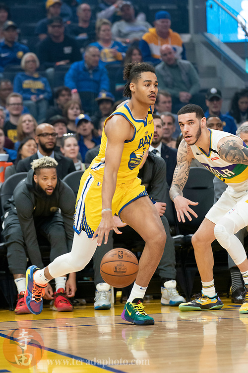 February 23, 2020; San Francisco, California, USA; Golden State Warriors guard Jordan Poole (3) dribbles the basketball against New Orleans Pelicans guard Lonzo Ball (2) during the first quarter at Chase Center.