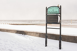 It doesn't happen very often but this morning there was a thick blanket of snow on Portobello beach. Beach volleyball pair Mel Coutts and Lynne Beattie must be delighted to be in Fort Lauderdale for their Commonwealth Games preparation and not training on their usual court! No swimmers today!<br /> <br /> <br /> © Jon Davey/ EEm