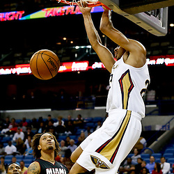 Oct 23, 2013; New Orleans, LA, USA; New Orleans Pelicans power forward Anthony Davis (23) dunks against the Miami Heat during the second half of a preseason game at New Orleans Arena. The Heat defeated the Pelicans 108-95. Mandatory Credit: Derick E. Hingle-USA TODAY Sports