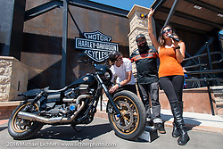 Jesse Rooke with HD employees at the Harley-Davidson plaza on Main Street during the annual Sturgis Black Hills Motorcycle Rally.  SD, USA.  August 7, 2016.  Photography ©2016 Michael Lichter.