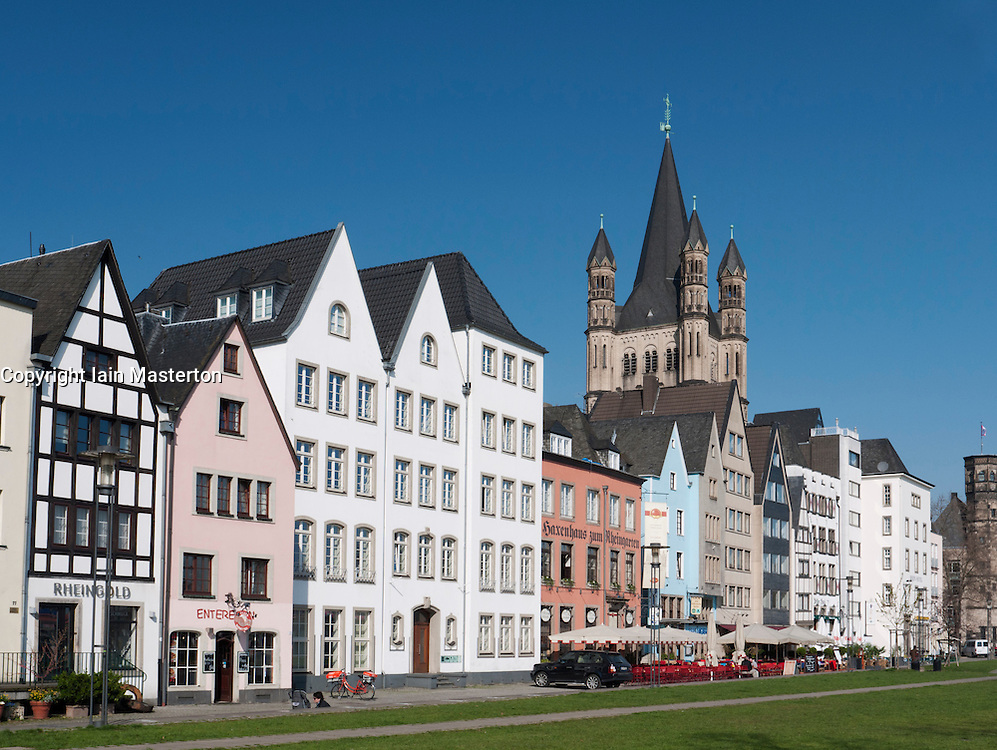 Historic style buildings and Gross St Martins Church in Altstadt or Old Town of Cologne beside the river Rhine Germany