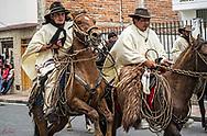 A rider on a rambuncious horse during El Chagra parade in Cotacachi, Ecuador.