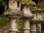 Stone lanterns with a deer image leading up to the Kasuga Taisha Shrine, Nara, Japan