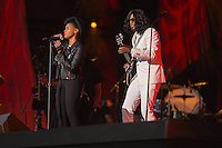 Janelle Monàe, left, and Kellindo Parker perform at the Global Citizen's Festival in New York's Central Park. <br /> <br /> <br /> The free, ticketed event is part of the Global Citizen platform, a social media and live-event campaign. Musicians and celebrities join dignitaries and philanthropists to urge world leaders to act towards ending extreme poverty by 2030. Free tickets were earned by fans who logged on to www.globalfestival.com to learn and share content about four main themes: education, women's equality, global health and global partnerships.<br /> <br /> (Photo by Robert Caplin) 2013 Global Citizen's Festival. <br /> <br /> Photo ©Robert Caplin
