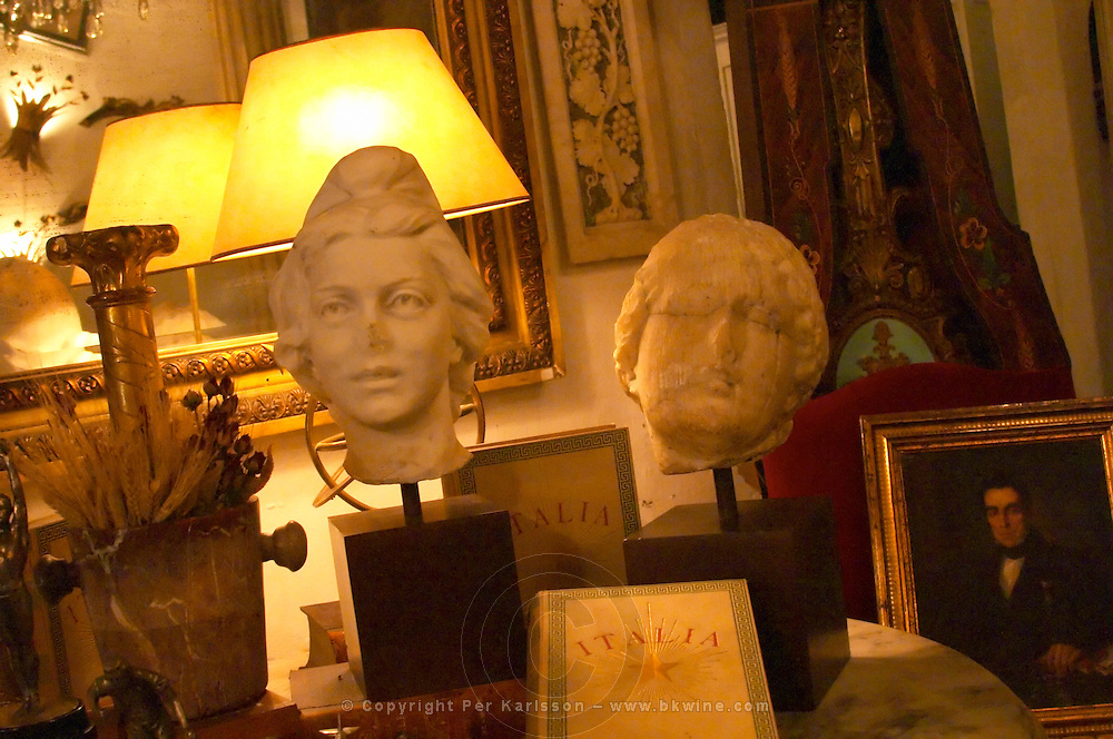 Interior of an antique shop in the San Telmo district around Plaza Dorrego Square, two sculptured heads old books Italia, framed paintings and more Calle Defensa Defence street Buenos Aires Argentina, South America