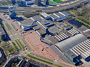 Nederland, Noord-Holland, Amsterdam; 23-03-2020; RAI Amsterdam, Europaplein - geen publiek, de RAI is gesloten tgv de corina-crisis.<br /> Het publieke leven in het centrum van de hoofdstad is bijna geheel stil komen te liggen als gevolg van het Corona virus. Niet alleen is alle horeca dicht, ook veel winkels en andere bedrijven zijn gesloten. Het publiek blijft over het algemeen binnen, de straten en pleinen zijn stil.<br /> <br /> Public life in the center of the capital has come to a complete standstill as a result of the Corona virus. Not only are all pubs, coffee shops and restaurants,  closed, many shops and other companies are also closed. The public generally stays inside, the streets and squares are very quiet.<br /> <br /> luchtfoto (toeslag op standaard tarieven);<br /> aerial photo (additional fee required)<br /> copyright © 2020 foto/photo Siebe Swart
