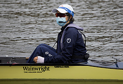 © Licensed to London News Pictures. 09/08/2021. Henley-on-Thames, UK. A cox wearing a face mask during training ahead of the the Henley Royal Regatta which starts on Wednesday. Established in 1839, the five day international rowing event, raced over a course of 2,112 meters (1 mile 550 yards), is considered an important part of the English social season. Photo credit: Ben Cawthra/LNP
